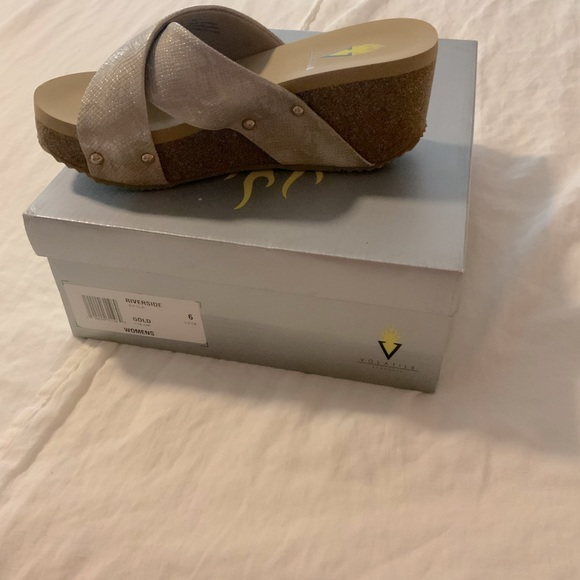 Volatile wedge sandal